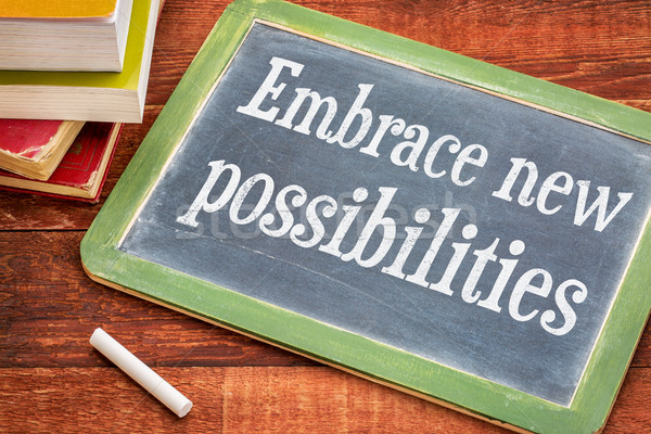 Embrace new possibilities on blackboard Stock photo © PixelsAway