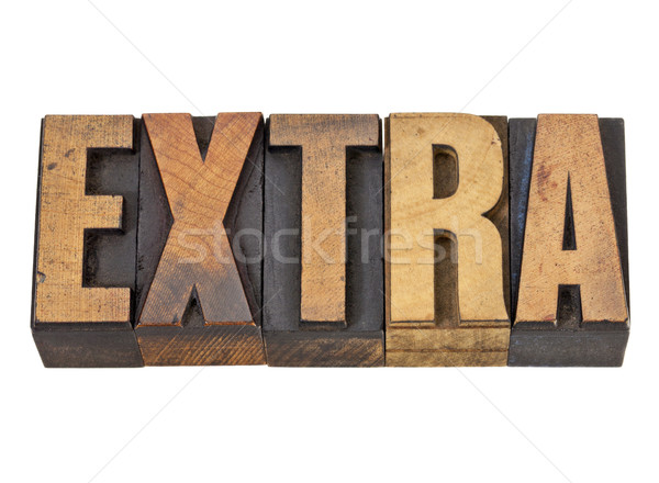 extra word in letterpress type Stock photo © PixelsAway