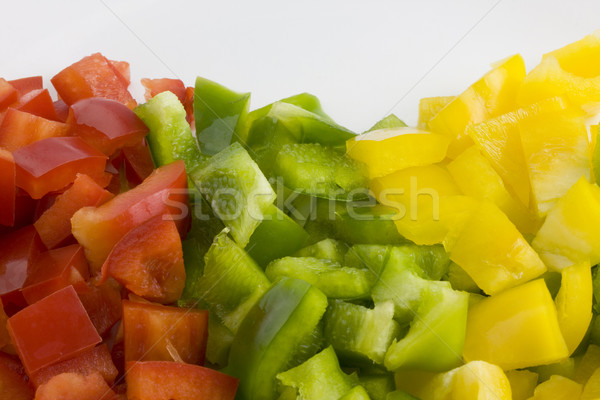 Stock photo: red, green and yellow pepper diced