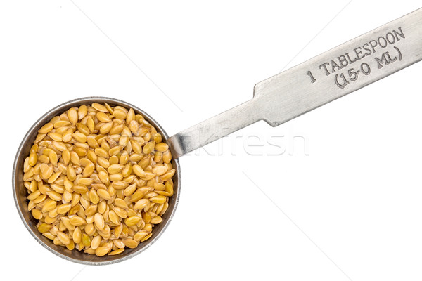 golden flax seed on measuring spoon Stock photo © PixelsAway