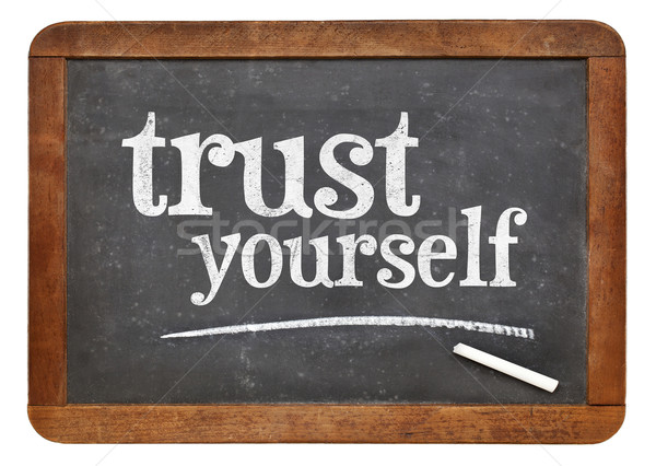 Trust yourself - blackboard sign Stock photo © PixelsAway