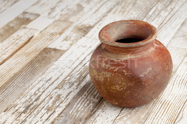 red clay pot on rustic table Stock photo © PixelsAway
