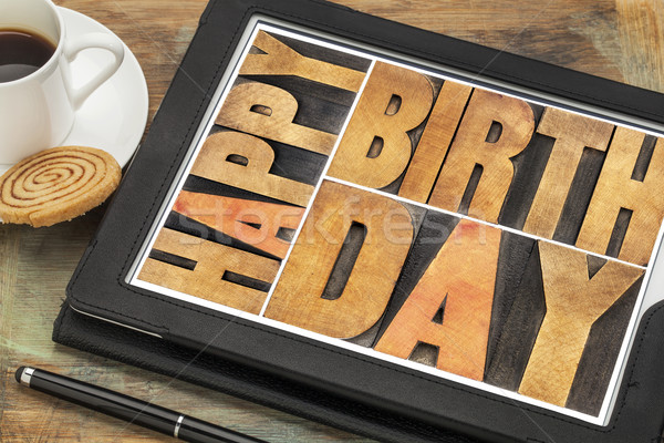 Happy birthday on digital tablet Stock photo © PixelsAway