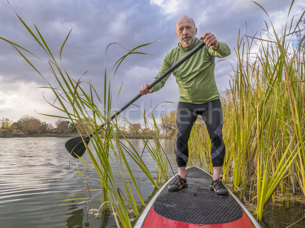 stand up paddling on a lake Stock photo © PixelsAway