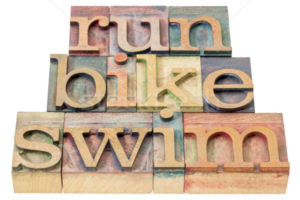 実行 自転車 泳ぐ トライアスロン 孤立した 言葉 ストックフォト © PixelsAway