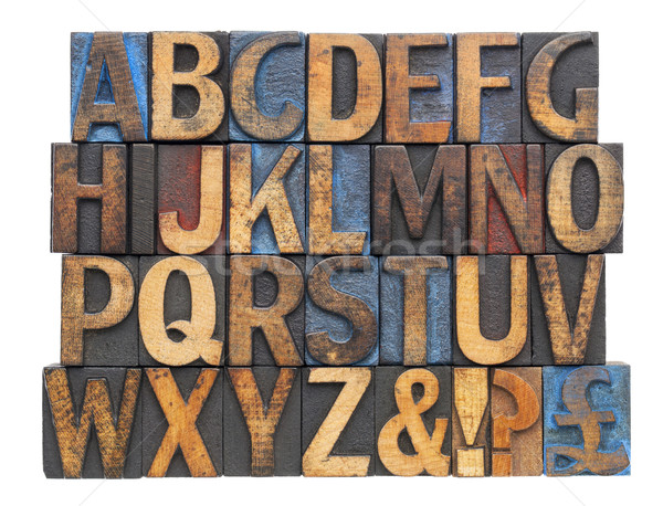 alphabet in antique wood type Stock photo © PixelsAway