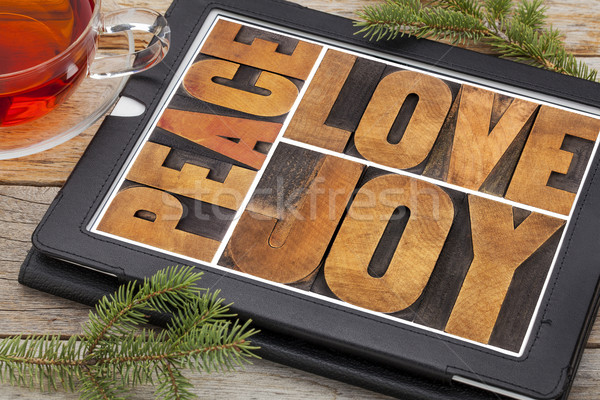 love, joy and peace on digital tablet Stock photo © PixelsAway