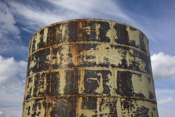 old rusty grain bin against partially cloudy sky Stock photo © PixelsAway