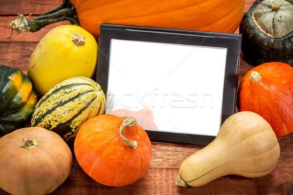 blank digital tablet with pumpkin and squash Stock photo © PixelsAway