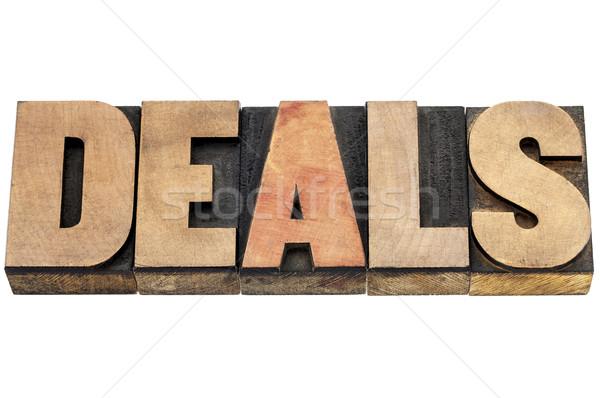 deals word in wood type Stock photo © PixelsAway