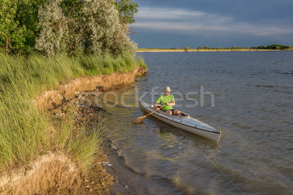 canoe paddling on lake in Colorado Stock photo © PixelsAway