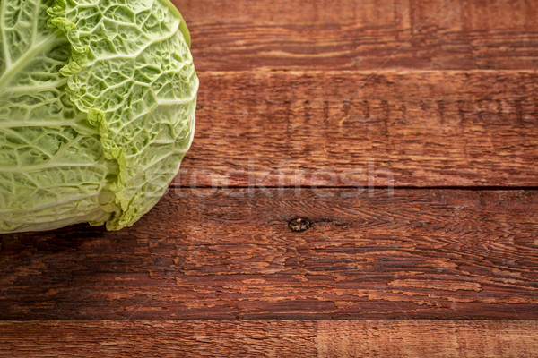 savoy cabbage on rustic wood Stock photo © PixelsAway