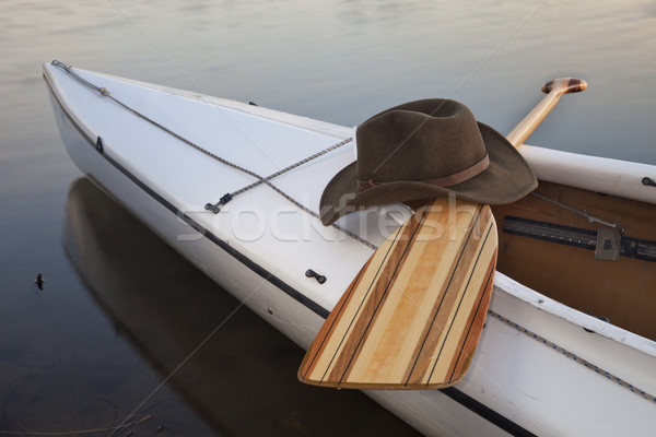 paddle, hat and canoe Stock photo © PixelsAway