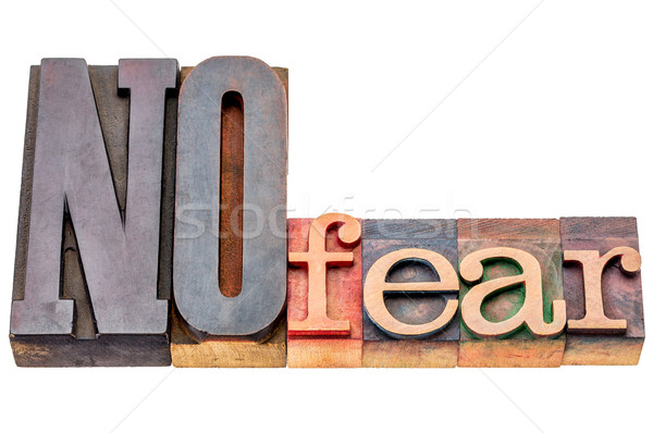 NO fear word abstract in wood type Stock photo © PixelsAway
