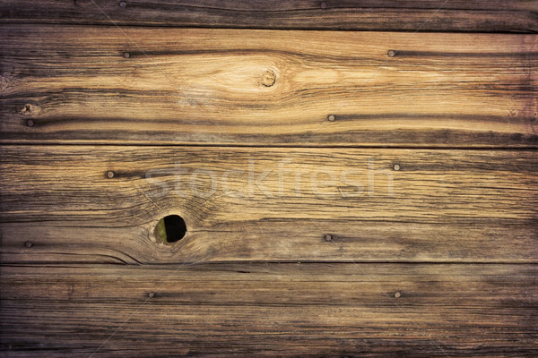 weathered grained wood of old barn wall Stock photo © PixelsAway