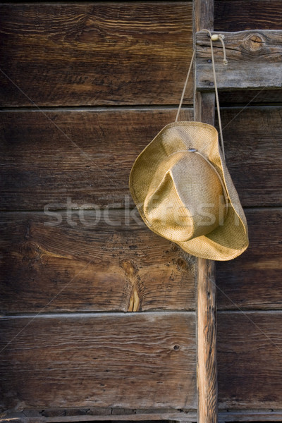cowboy straw hat against weathered wood Stock photo © PixelsAway