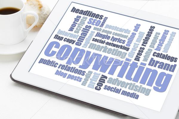 copywriting word cloud on tablet Stock photo © PixelsAway