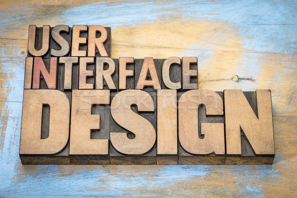 User interface design word abstract in wood type Stock photo © PixelsAway