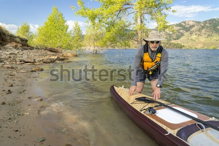 paddling fast sea kayak Stock photo © PixelsAway