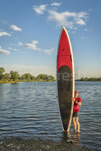 paddler and paddlleboard Stock photo © PixelsAway