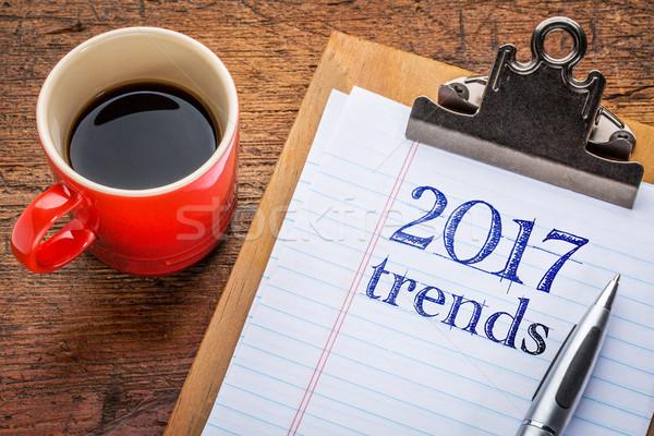 2017 trends on blackboard on clipboard Stock photo © PixelsAway