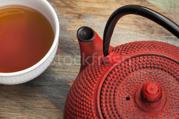 cup of tea with red tetsubin Stock photo © PixelsAway