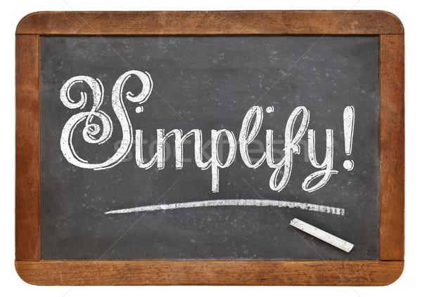 simplify word on blackboard Stock photo © PixelsAway