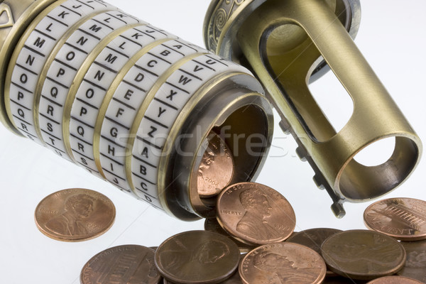 coins spilling out from open conbination puzzle box (cryptex) Stock photo © PixelsAway