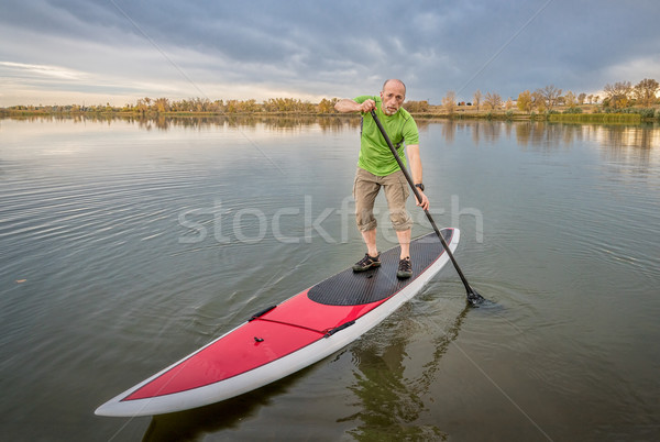 male paddler on stand up paddleboard Stock photo © PixelsAway