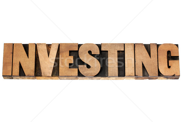 investing word in wood type Stock photo © PixelsAway