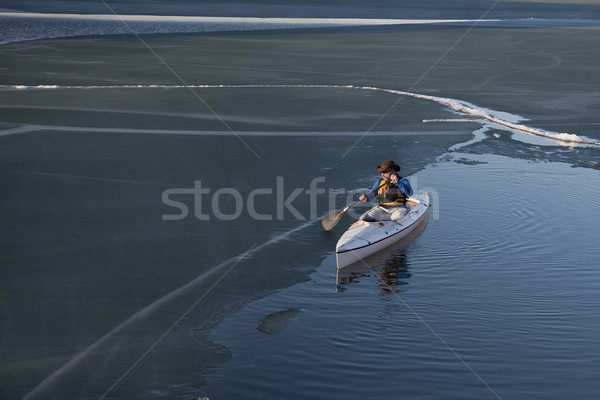 canoe paddling on ice covered lake Stock photo © PixelsAway