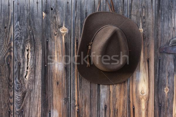 felt cowboy hat on barn wall  Stock photo © PixelsAway