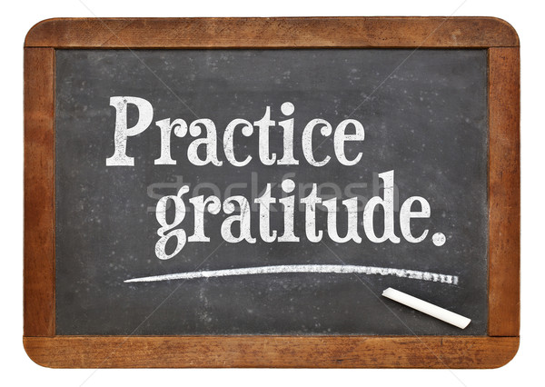 practice gratitude on blackboard Stock photo © PixelsAway