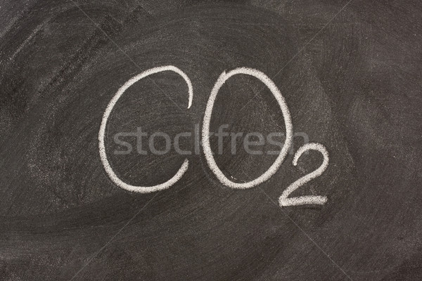 chemical symbol for carbon dioxide on a blackboard Stock photo © PixelsAway