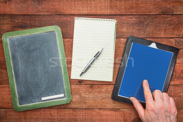 blackboard, notepad and digital tablet Stock photo © PixelsAway