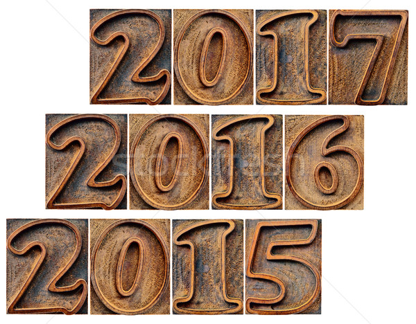 passing and incoming years in wood type Stock photo © PixelsAway