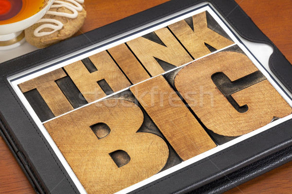 Stock photo: think big on digital tablet