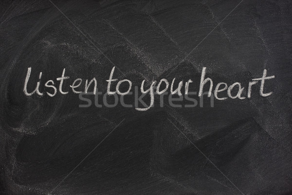 listen to your heart on a blackboard Stock photo © PixelsAway