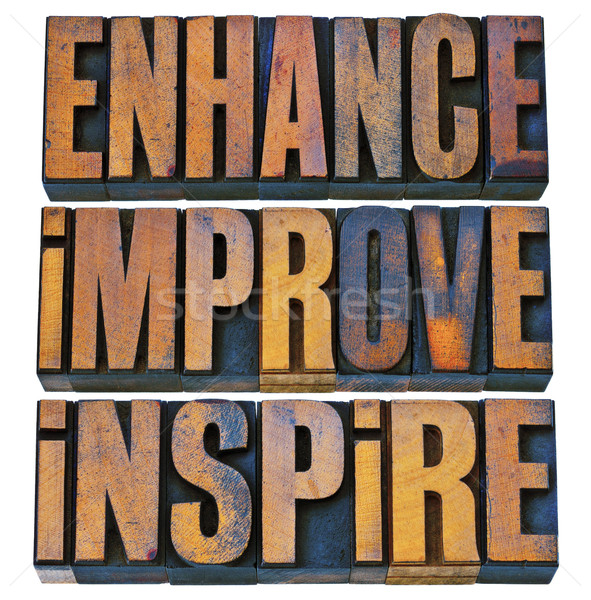 enhance, improve, inspire in wood type Stock photo © PixelsAway