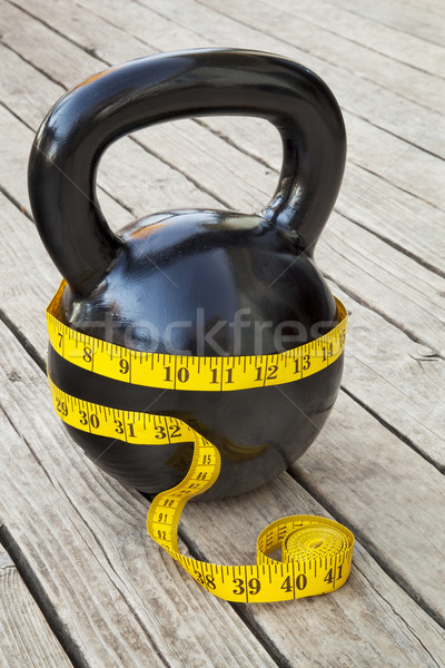 kettlebell and measuring tape Stock photo © PixelsAway