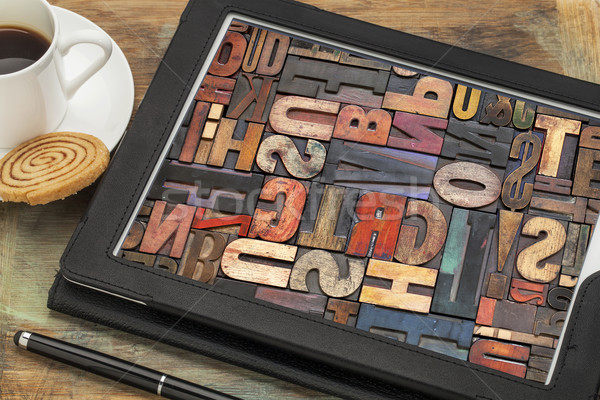 Stock photo: typography concept on digital tablet