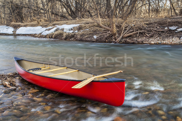 red canoe on a river Stock photo © PixelsAway