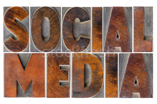 social media in wood type Stock photo © PixelsAway