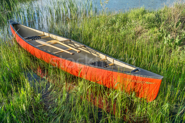 red canoe with wooden paddles Stock photo © PixelsAway