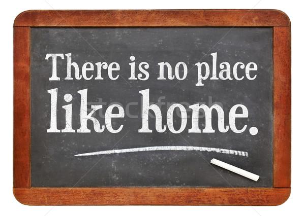 Geen plaats zoals home spreekwoord witte Stockfoto © PixelsAway