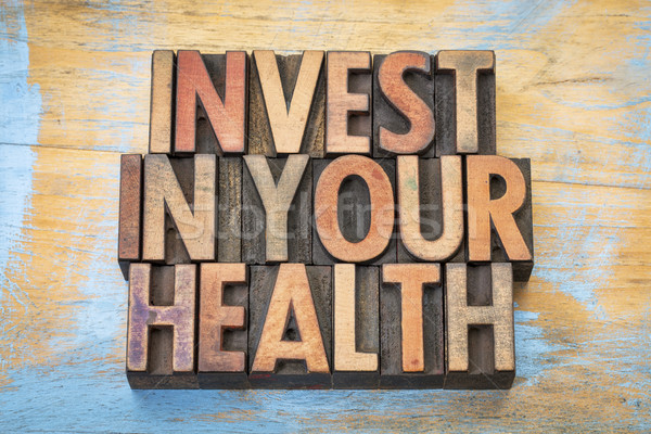 invest in your health in wood type Stock photo © PixelsAway