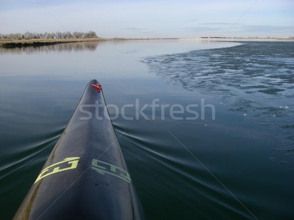 racing kayak on a partially frozen lake Stock photo © PixelsAway