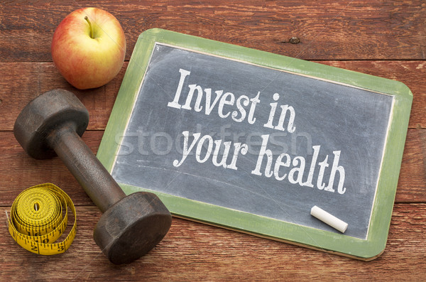 Invest in your health advice on blackboard Stock photo © PixelsAway
