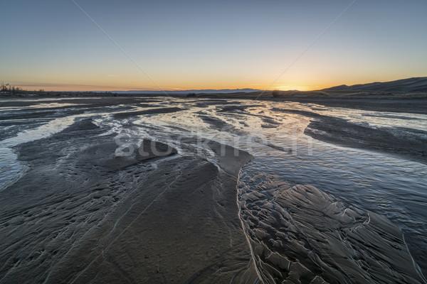 Pôr do sol enseada raso areia parque Foto stock © PixelsAway