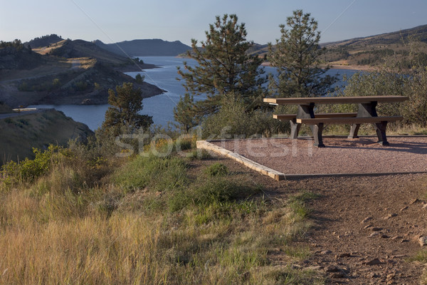 picnic table on shore of mountain reservoir Stock photo © PixelsAway